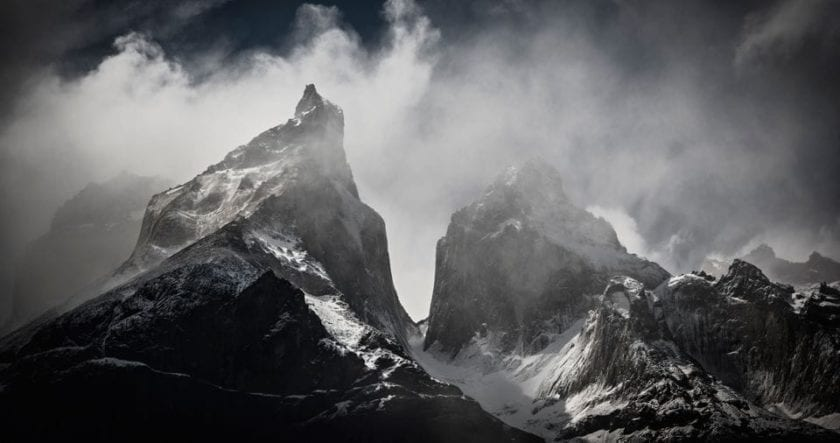 Close-up view of Cuernos del Paine surrounded by dramatic clouds