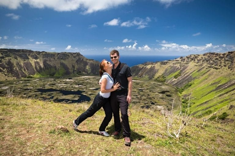 View of a couple in Easter Island, with Rano Kau crater in the background