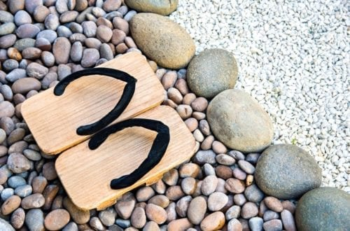 View of traditional Japanese wooden slippers worn inside a ryokan.