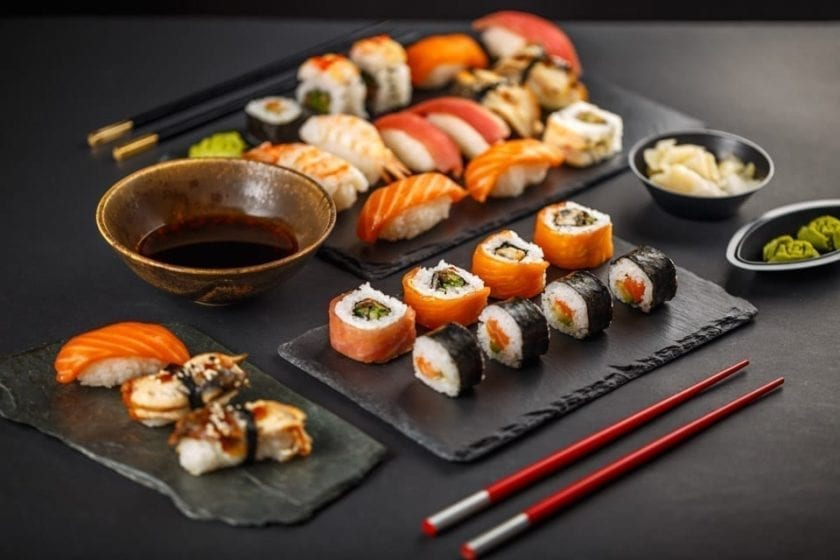 A picture of nigirizushi and makizushi, classic samples of famous Japanese food.