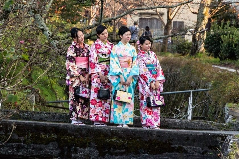 Girls in kimonos taking a picture on the philosopher's path in Kyoto