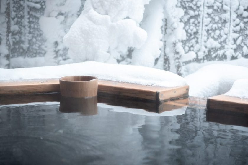 A view of an onsen. Visiting an outdoor hot tub is a perfect bucket list experience in Japan.