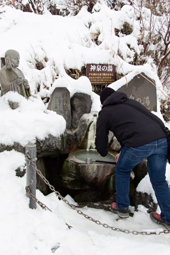 washing hands in a spring in Japan