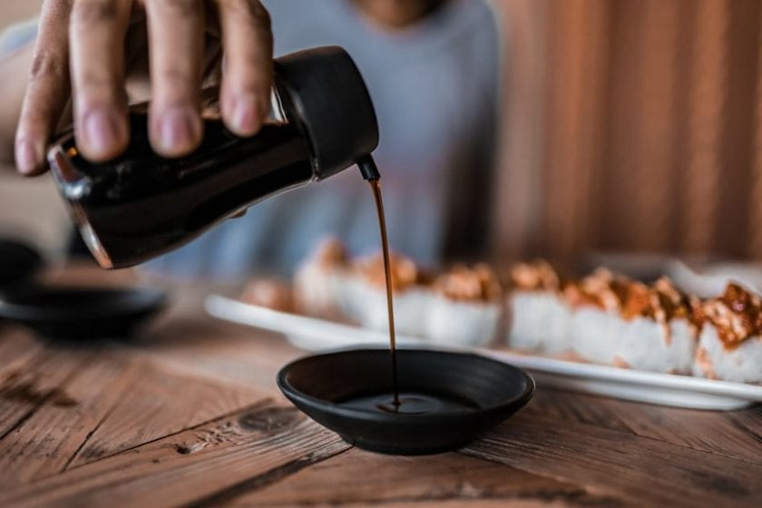 soy sauce being poured