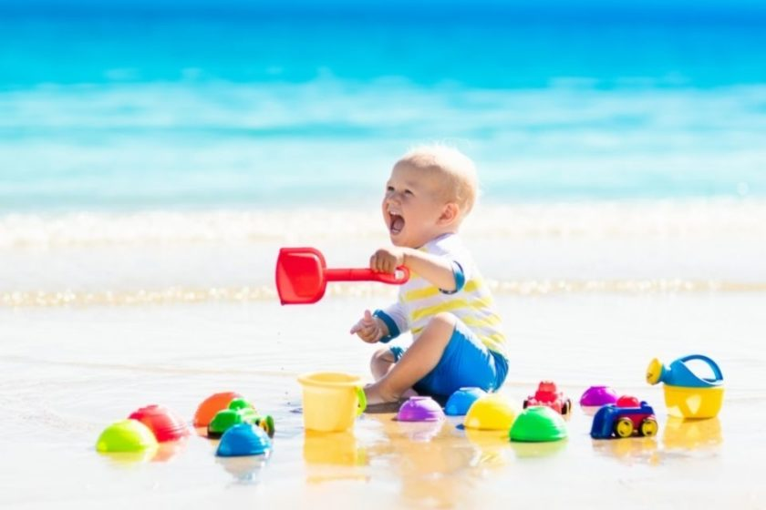 toddler playing on a beach